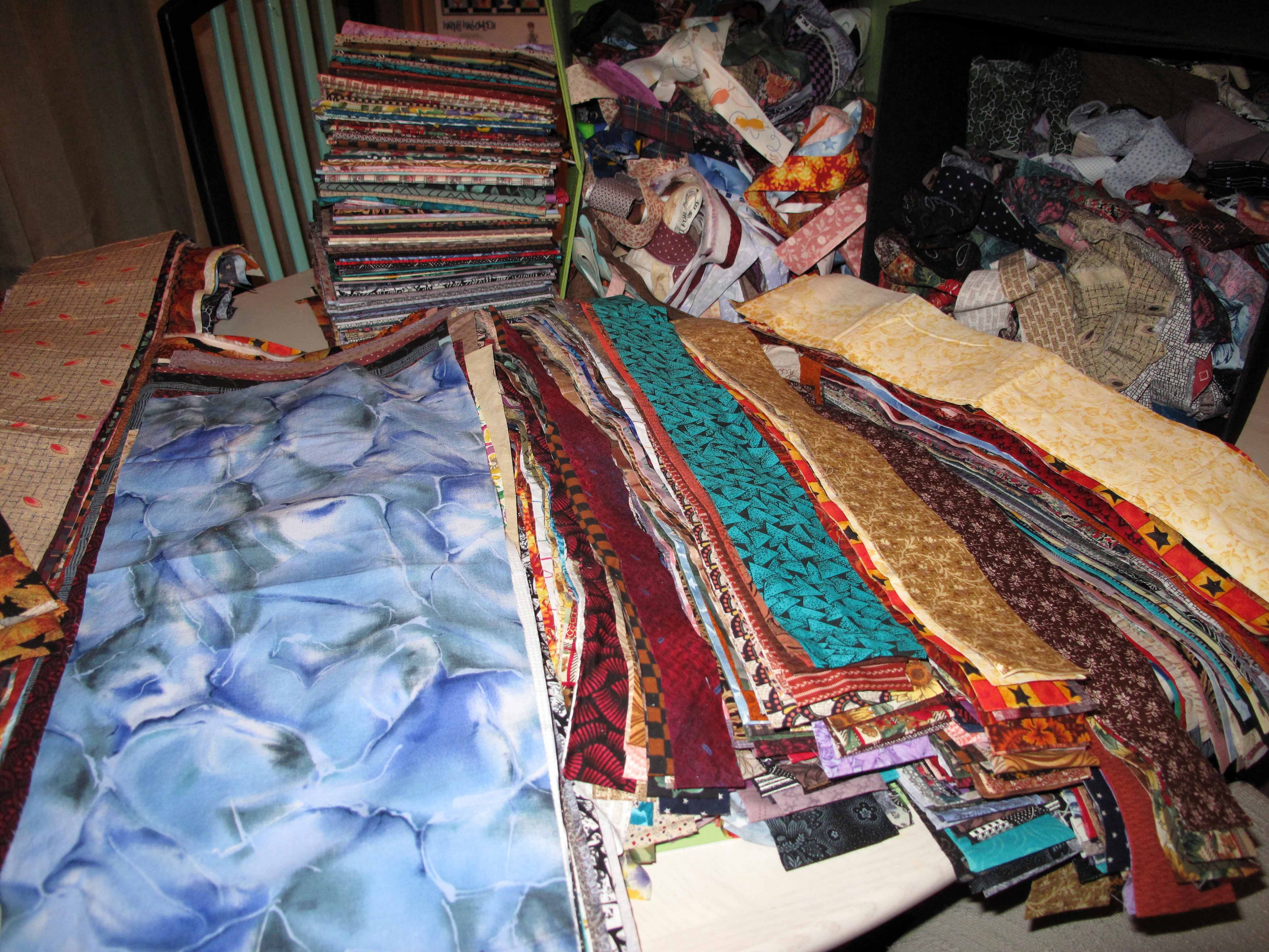 200+ fabrics cut up for scrap quilting